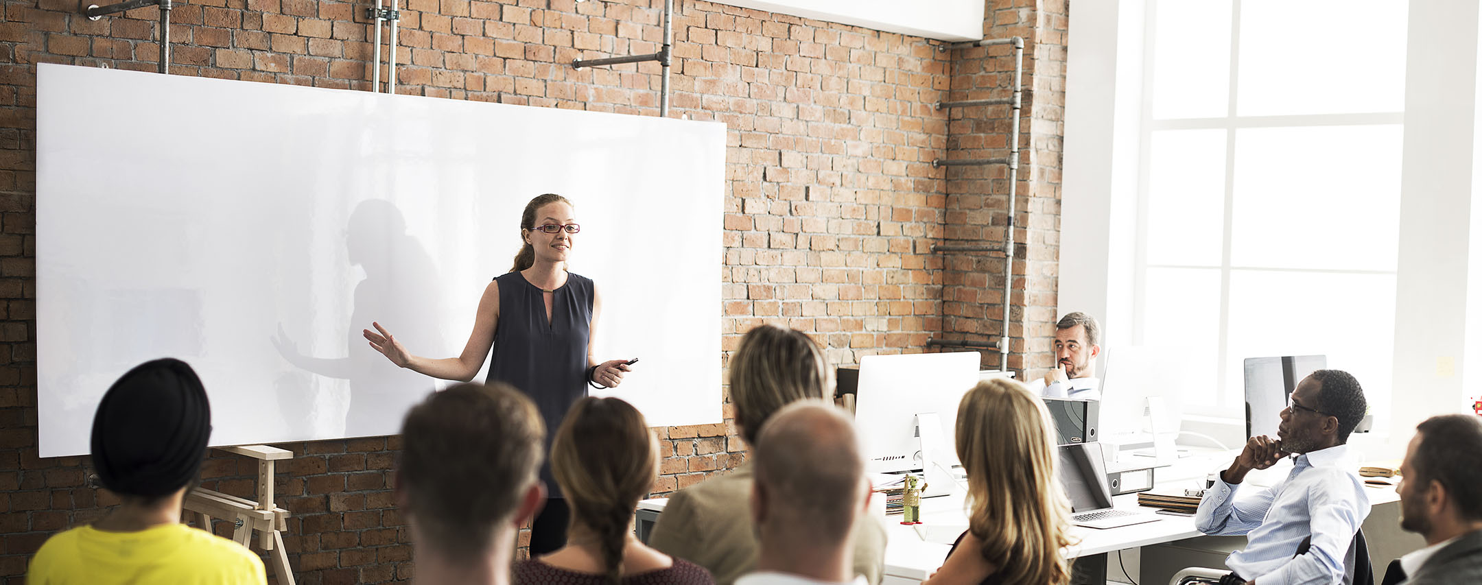 Woman holding a training session for her employees