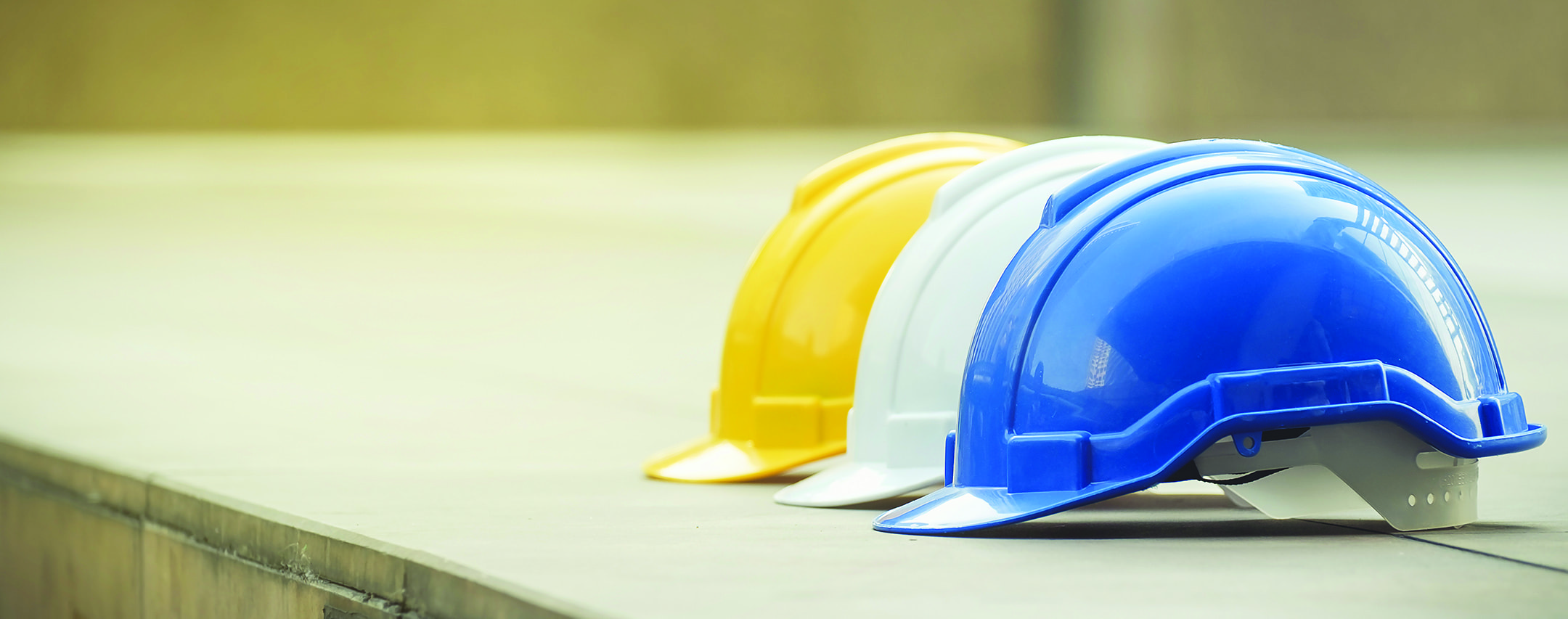 three hard construction hats lined up